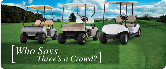 three Trojan battery-powered golf carts